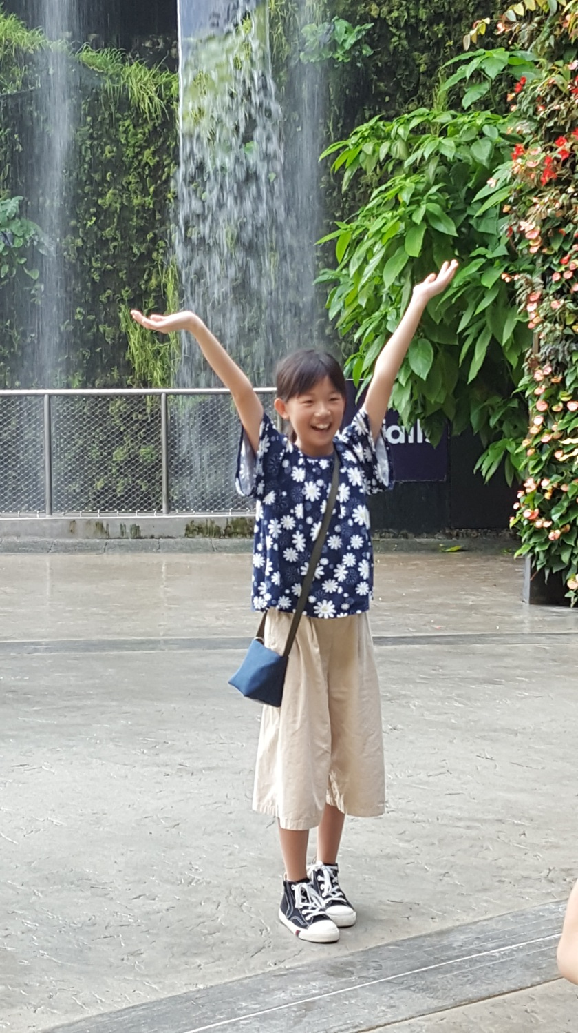 Hands up! Girl at Singapore Botanical Gardens