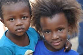 S Africa, Kuyasa, 2 girls in blue