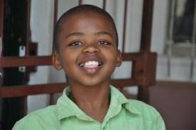 S Africa, Kuyasa happy boy in green