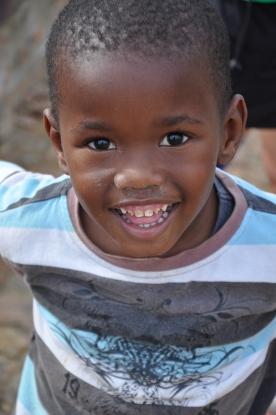 S Africa, smiling boy at Kuyasa