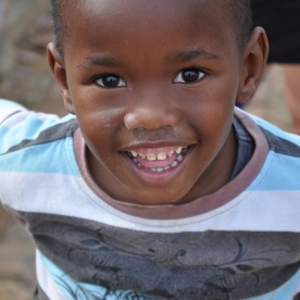 S Africa, smiling boy at Kuyasa