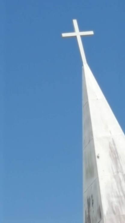 Cross on white steeple, N Florida