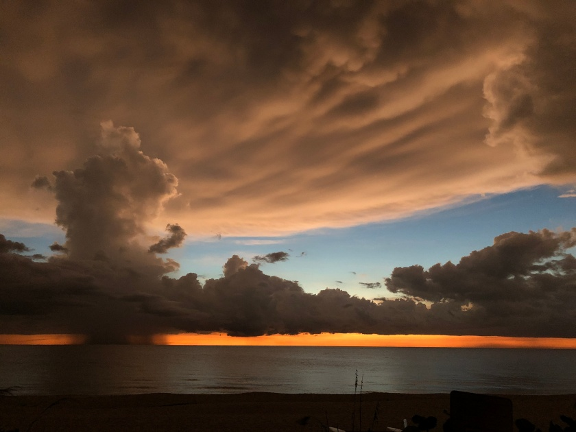 Sunset w orange, clouds, rain