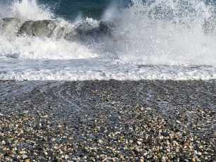 Waves crashing sand, rocks, Western NZ