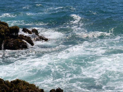 Pacific Coast, turbulent water against rocks