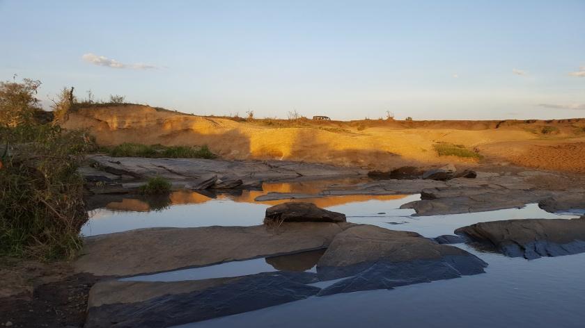 masai mara flat rocks reflections