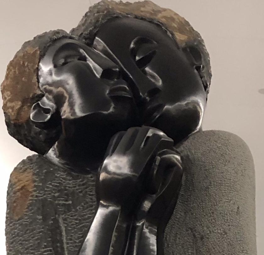 Two bronze people embracing, Atlanta airport
