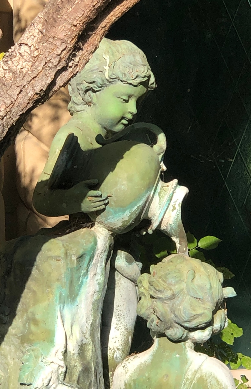 Bronze sculpture of boy pouring water for another, Dana Point, CA