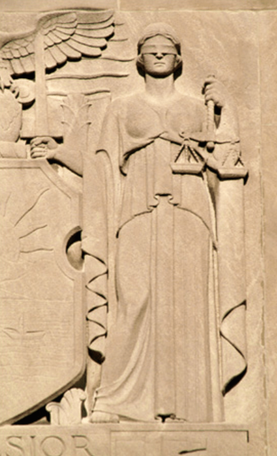 Lady Justice w scales, relief