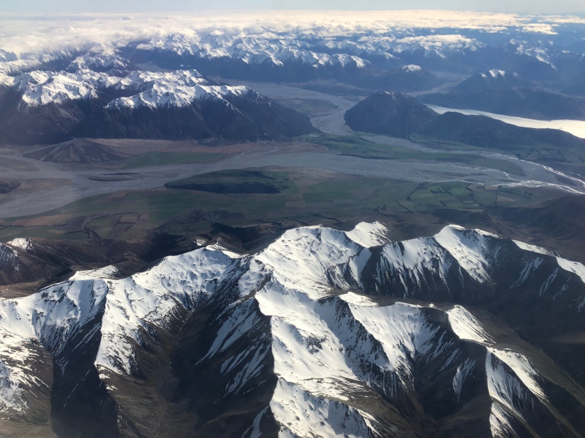 NZ snow-capped mountains, lakes from air